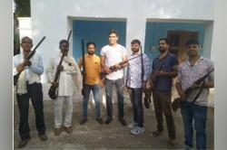 Munaf Patel Carrying Rifle