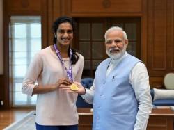 Pv Sindhu Meets Pm Modi Kiren Rijiju Receives Rs 10 Lakh Cheque