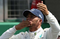 Hamilton Gets His Hands On The Formula One Trophy