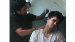 Indian Batting Legend Sachin Tendulkar Turns Barber For Son Arjun